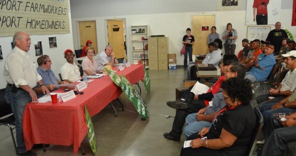 FLOC president Baldemar Velasquez speaks from a panel listening to farmworkers, alongside British MP Jim Sheridan, AFL-CIO Executive Vice President Tefere Gabre, U.S. Congresswoman Marcy Kaptur, and British MP Ian Lavery