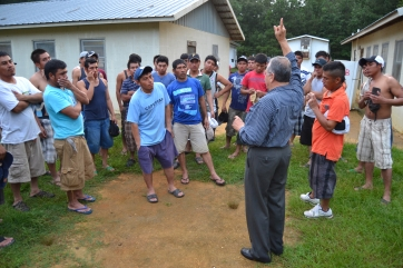 Father Tony briefing farmworkers