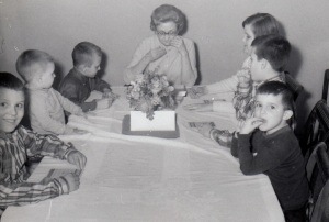 Playing  board game with Grandma after Sunday dinner in 1968: Ed, Ken, Bill, Grandma, Barb, Bob, Mike