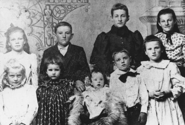 Children of Pius Anselm Durbin. Back: Margaret Elizabeth, William Oscar, Mary Eleanor, Elizabeth Ellen. Front: Katherine, Anna Christina, Fidelis Francis, Leo Douglas, Clara Loretta