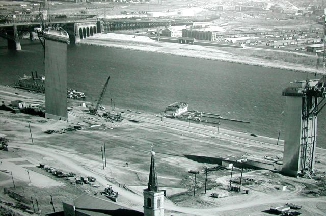 The St. Louis Gateway Arch under construction in 1964. Visible across the river, at the East St. Louis side of the Eads Bridge, is the New York Central Railroad where my dad, his brother Bob and parents all worked.